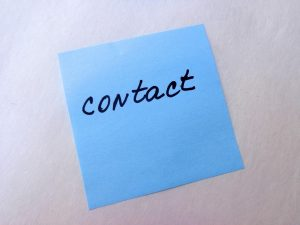 contact written on a post-it note